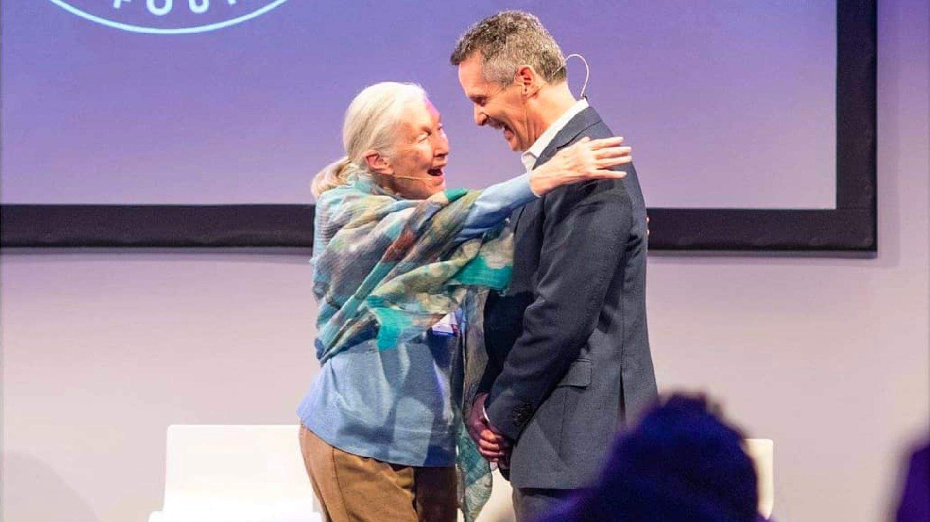 Jane Goodall embracing Dan Springer